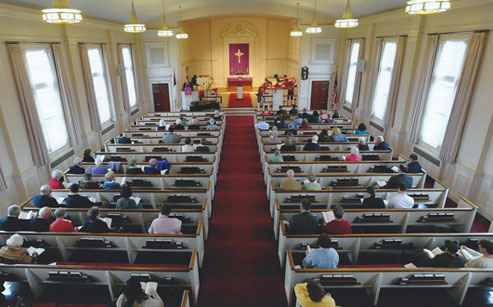 View of people seated inside the Federated Church sanctuary