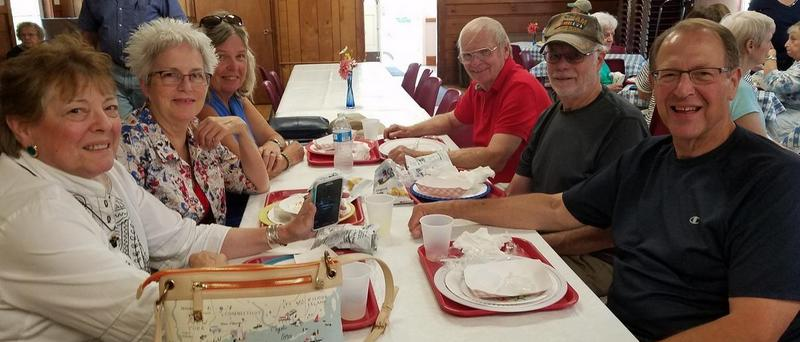 6 people eating lobster lunch