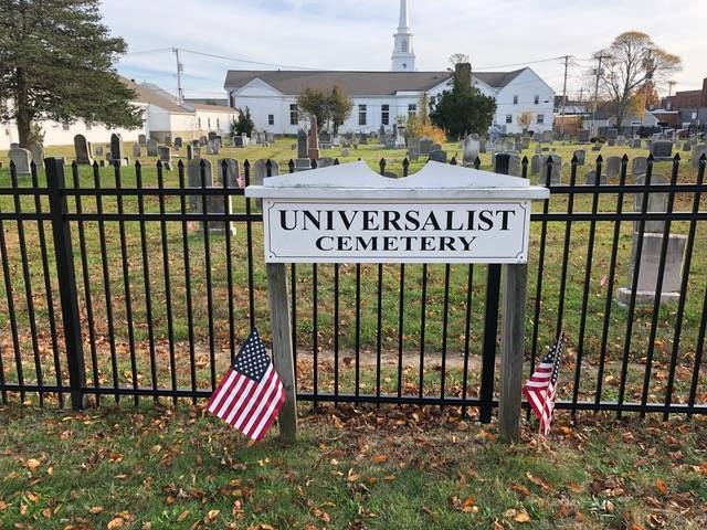 Sign on the fence outside the cemetery